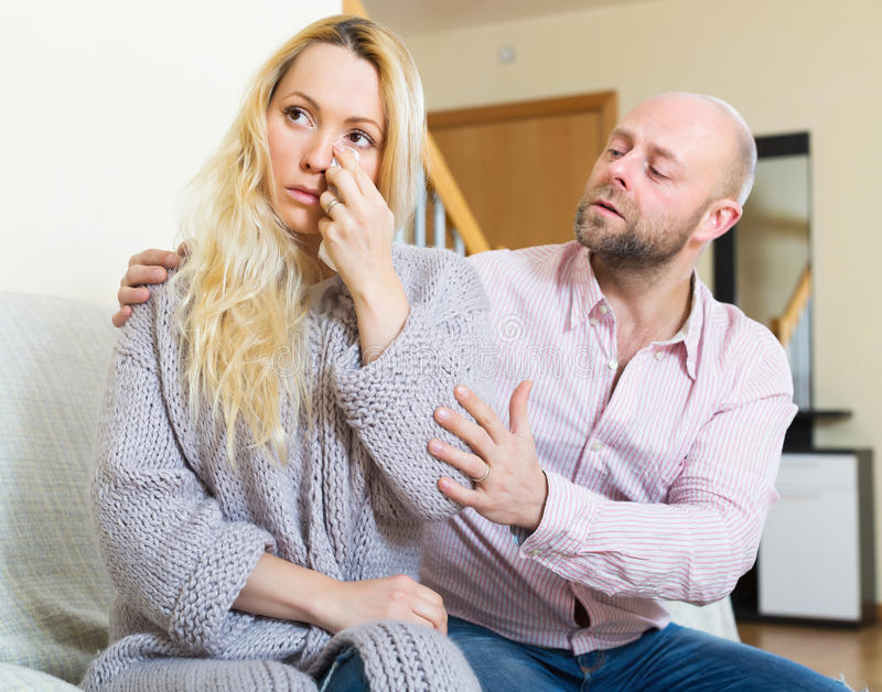 Man tries reconcile with woman. Man tries reconcile with women after quarrel. Focus on girl royalty free stock images