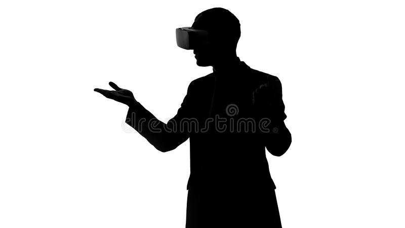Man tries virtual reality for the first time, wearing vr headset, grasping moves royalty free stock photography