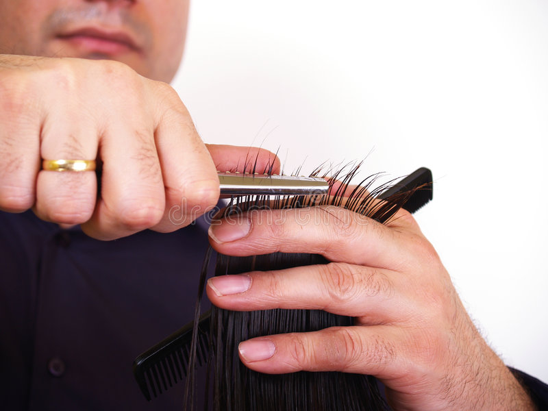 Man trim woman hairs. Married man trimming womens hairs royalty free stock photo