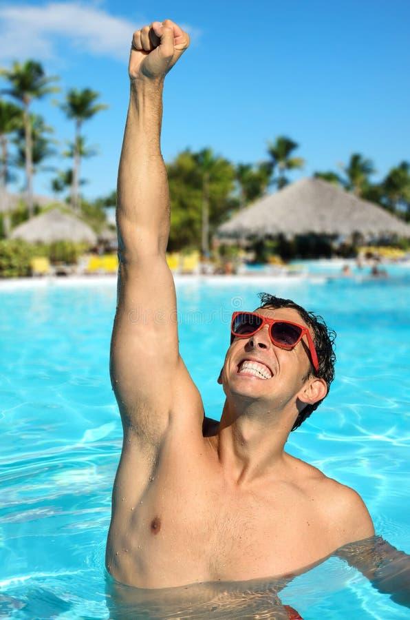 Man in tropical resort pool royalty free stock images