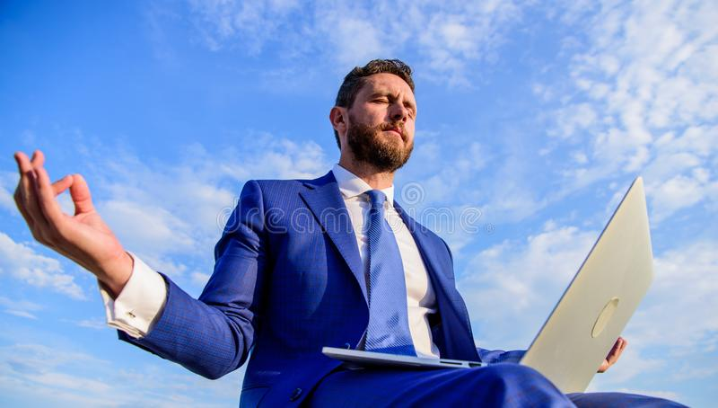 Man try keep his mind clear. Entrepreneur find minute relax and meditate. Work online can be annoying. Communication stock photography