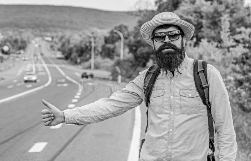 Man try stop car thumb up. Travel by autostop. Hitchhiking one of cheapest ways traveling. Hitchhikers can meet lot of. People and make lots friends. Autostop royalty free stock images