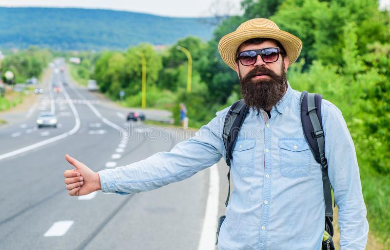 Man try stop car thumb up. Travel by autostop. Hitchhiking one of cheapest ways traveling. Hitchhikers can meet lot of royalty free stock photo
