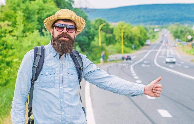 Man try stop car thumb up. Travel by autostop. Hitchhiking one of cheapest ways traveling. Hitchhikers can meet lot of. People and make lots friends. Autostop stock photography