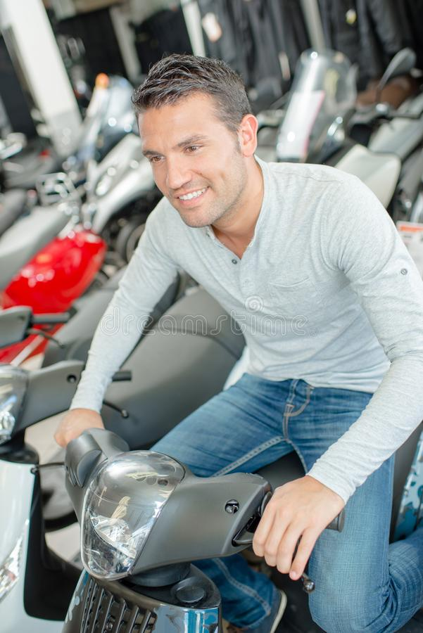 Man trying a scooter. Bike royalty free stock image
