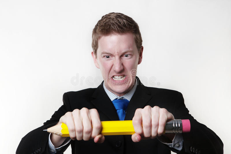 Man Trying To Break His Large Pencil Royalty Free Stock Photo