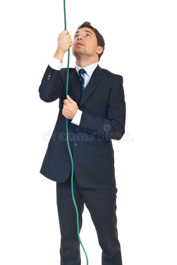 Man trying to climbing rope royalty free stock photo