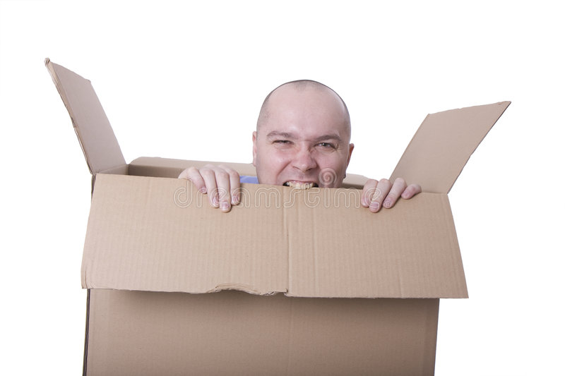 Man trying to escape from a cardboard box