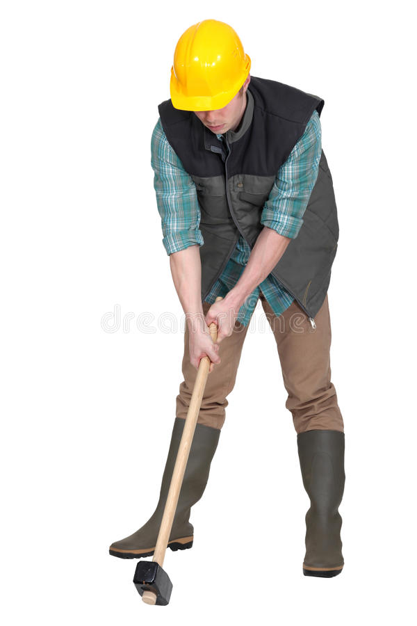 Download Man Trying To Lift Sledge-hammer Royalty Free Stock Images - Image: 27804389