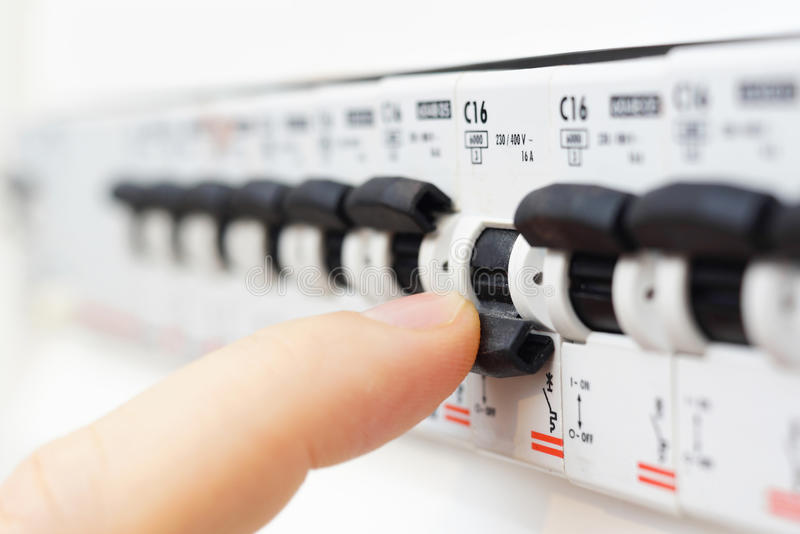 Man turning off the fusebox royalty free stock photos