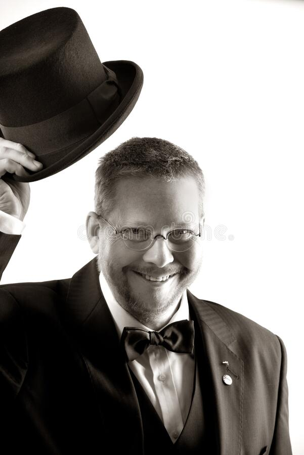 Man In Tuxedo And Eyeglasses Holding Top Hat In Grayscale Free Public Domain Cc0 Image