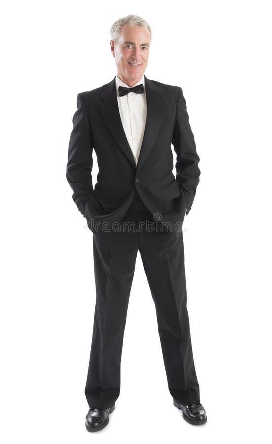 Man In Tuxedo Standing With Hands In Pocket