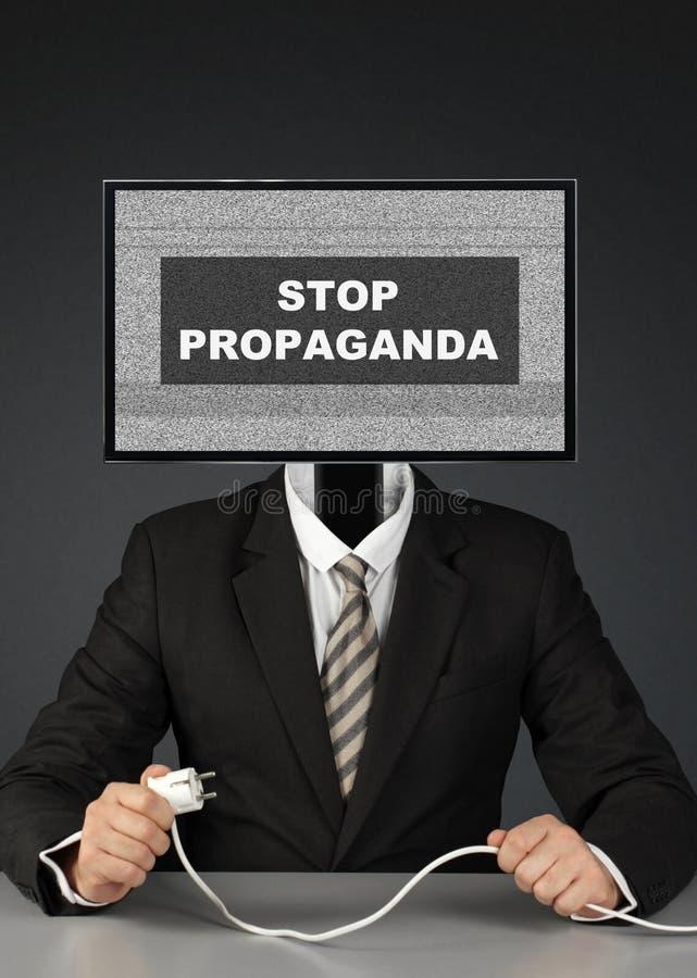 Man with tv head, stop mass media propaganda concept. Businessman with tv head, stop mass media propaganda concept royalty free stock photos