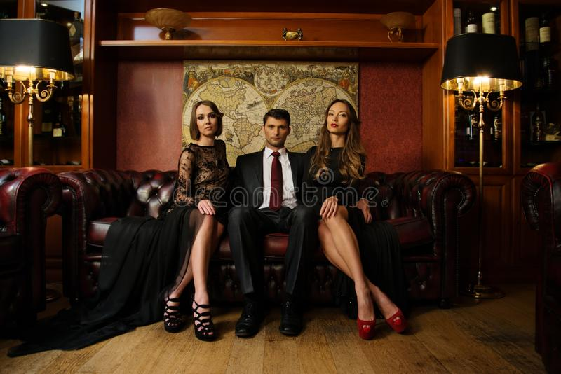 Download Man With Two Beautiful Women Stock Photography - Image: 34645242