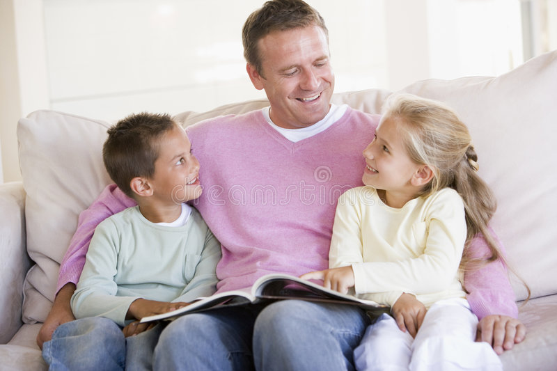 Man And Two Children Sitting In Living Room Stock Photo - Image of ...