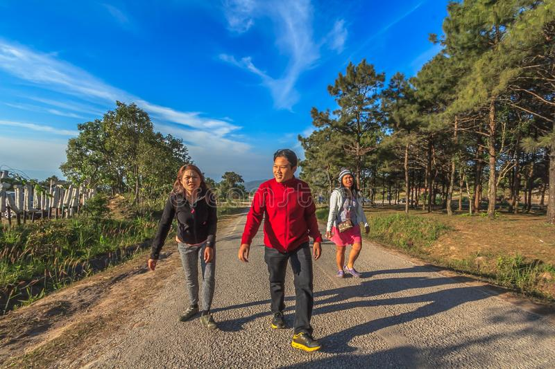 Man and Two Women Walking stock images