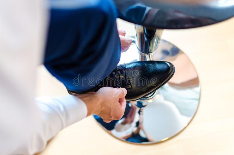 Man tying shoelaces royalty free stock photos