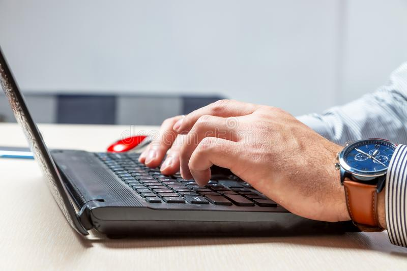 A man types on the keyboard. Hands and fingers on buttons close up stock images