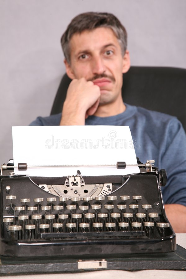 Man and typewriter 2. Man and typewriter with blank white sheet 2 royalty free stock photos