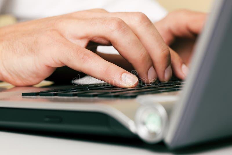Man typing computer keyboard royalty free stock photography