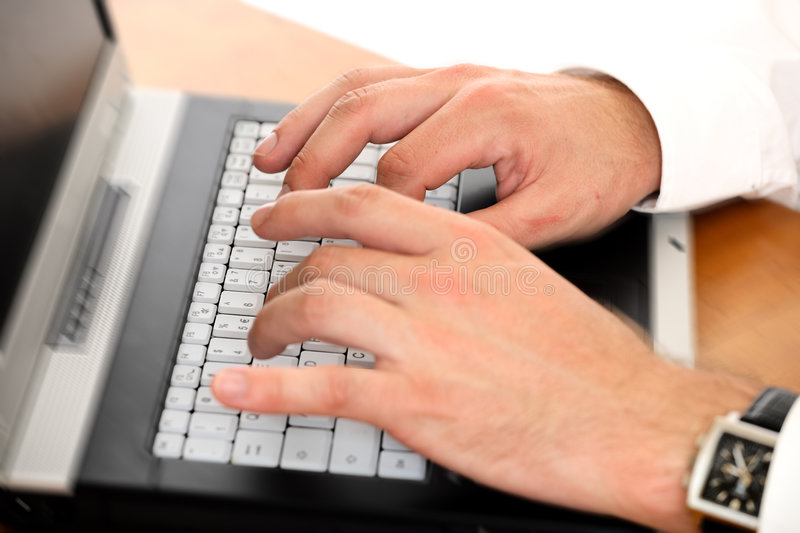 Man typing on a laptop 2 stock image