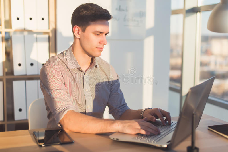 Man typing text or blog in office, hir workplace, using pc keyboard. Busyman working. Man typing text or blog in office, hir workplace, using pc keyboard royalty free stock photo