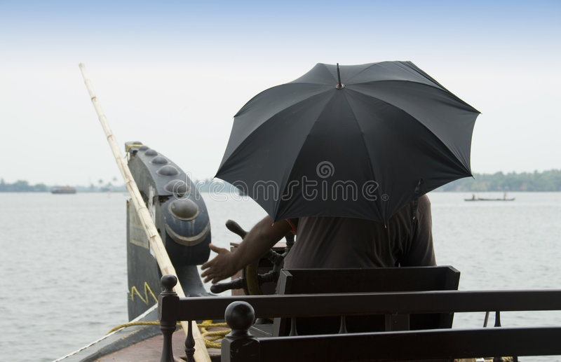 Download Man With Umbrella Steers A Houseboat Royalty Free Stock Images - Image: 5019199