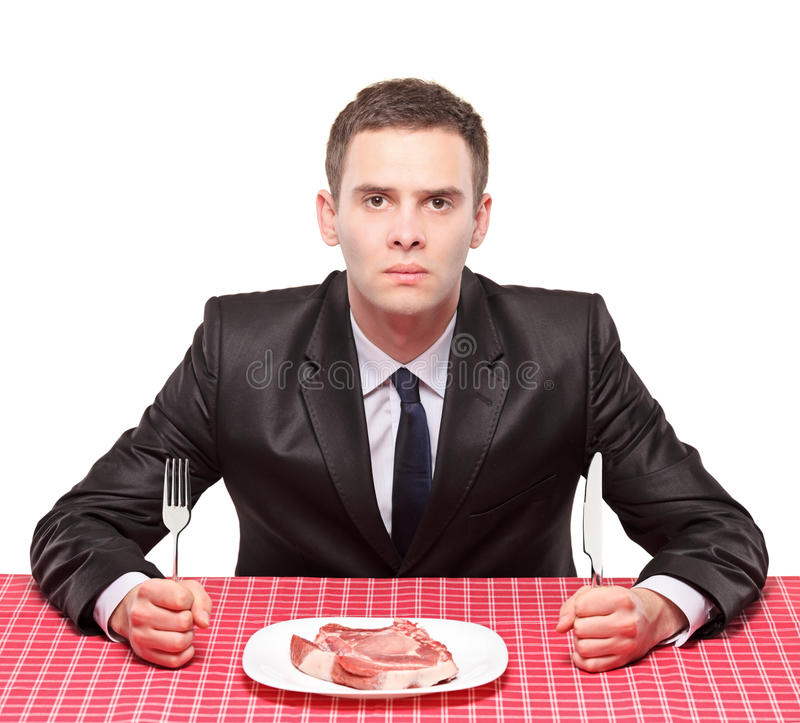A man and an uncooked beef stock photography