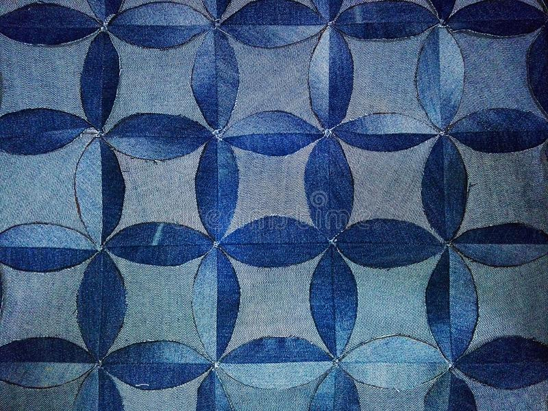 Pattern of blue flowers, forming curved rhombuses,. Design pattern in different shades of blue royalty free stock photos