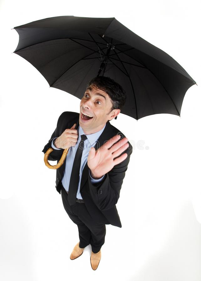 Man under an umbrella having. An inspirational breakthrough looking up with his hand raised and a look of ecstatic wonderment on his face, comic high angle stock images