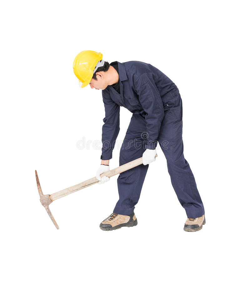 Man in uniform hold old pick mattock that is a mining device royalty free stock photography