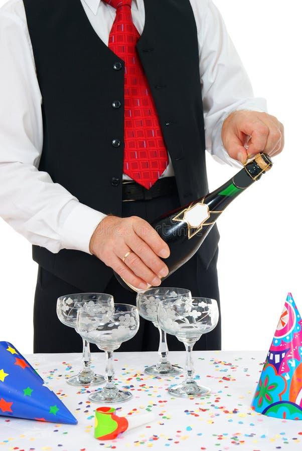 Man unlocks champagne royalty free stock photography