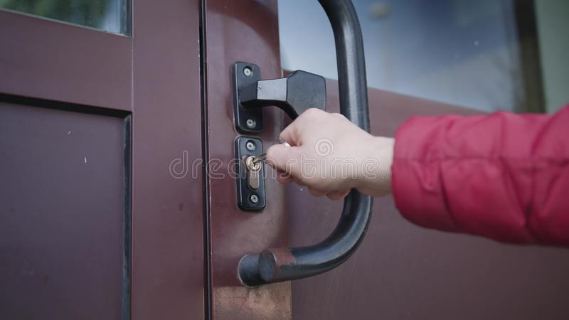 Man Unlocking a Door and Coming In stock images