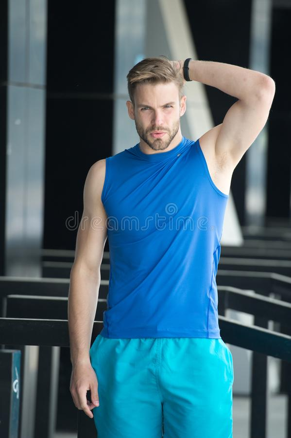 Man unsatisfied his antiperspirant. Sportsman after training feel sweat smell. Guy check armpit sweaty skin. Prevent or royalty free stock photography