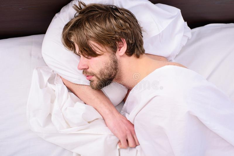 Man unshaven handsome relaxing bed. Power napping may help you get through day. Have nap relax. Man sleepy drowsy royalty free stock images