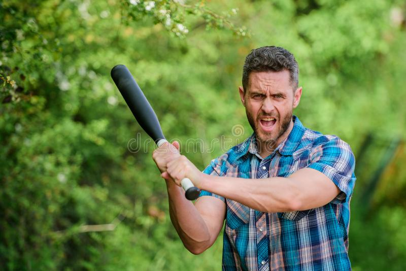 Man unshaven strict face hold black baseball bat. Strong temper. Principle concept. Confident in his strength. Bully guy royalty free stock photos