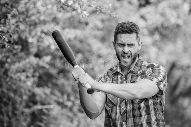 Man unshaven strict face hold black baseball bat. Strong temper. Principle concept. Confident in his strength. Bully guy royalty free stock images