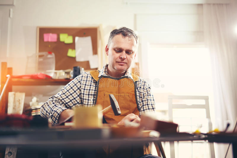 Man upholstering chair stock photography