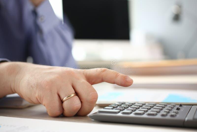 Man use Calculator Analyzing Company Investment stock photo