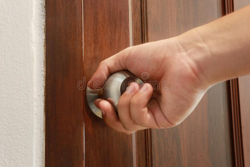 man use hand is opening the door. royalty free stock photo