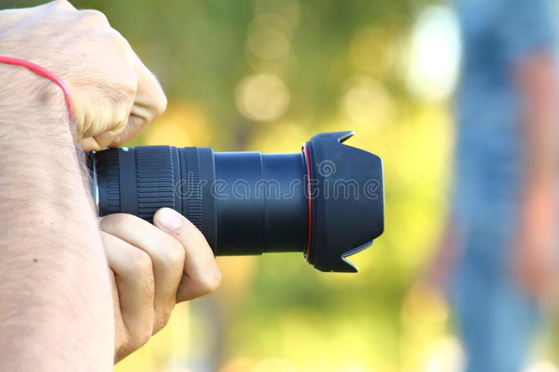 The man use the professional camera with telephoto lens. royalty free stock photography