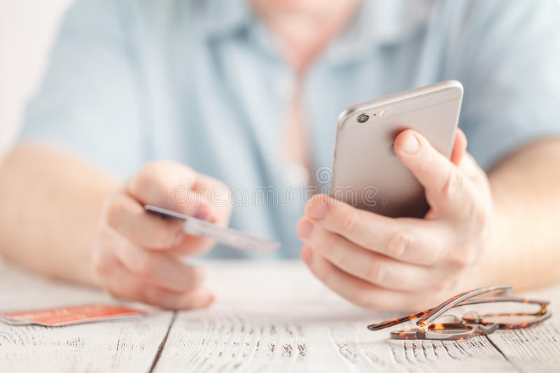 Man use smart phone and holding credit card with shopping online. Online payment concept. royalty free stock photography