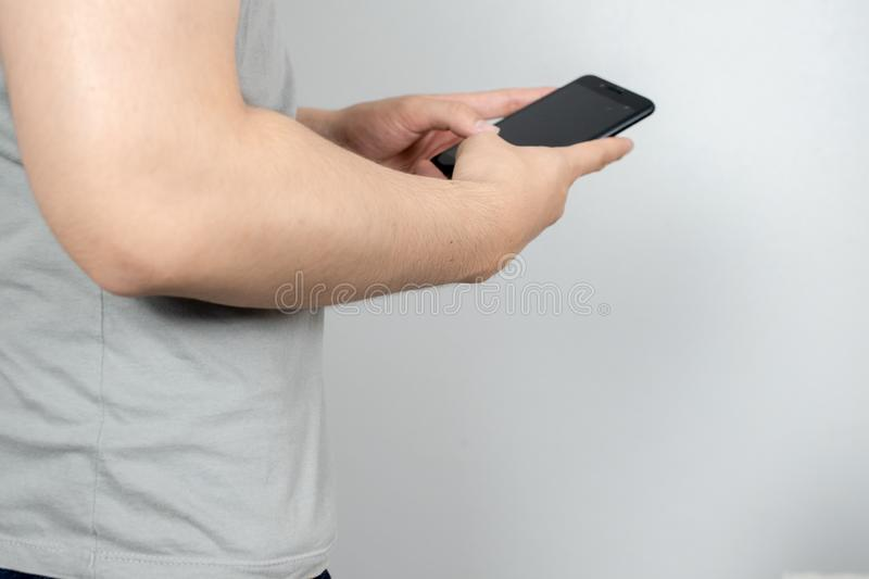 Man uses his Mobile Phone , close up stock image