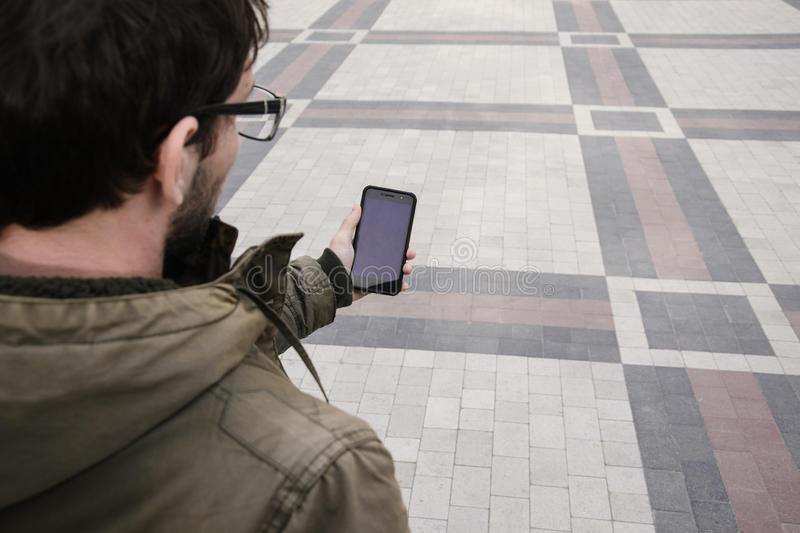 Man uses his Mobile Phone outdoor, close up stock photo