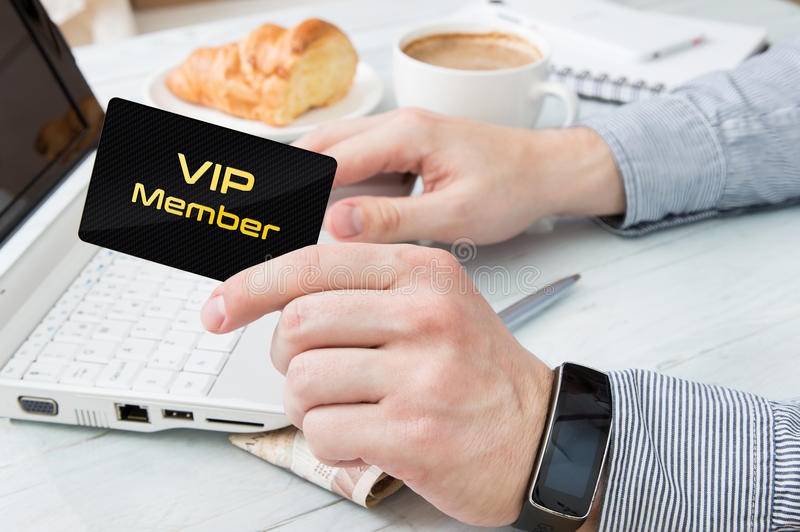 Man uses VIP member card. On the internet royalty free stock photos