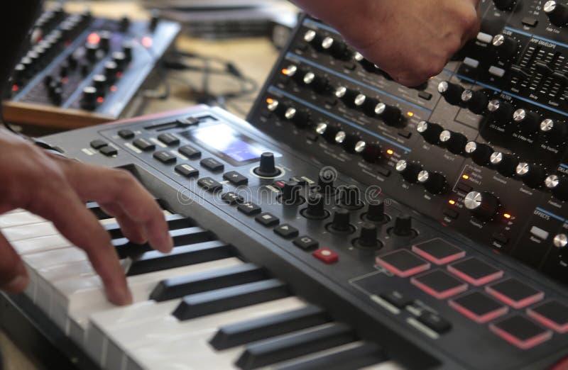 Man using antique analog synthesizer royalty free stock images