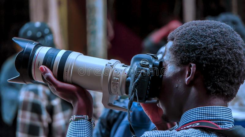 Man Using Black Dslr Camera With White and Black Zoom Lens Outdoor stock photo