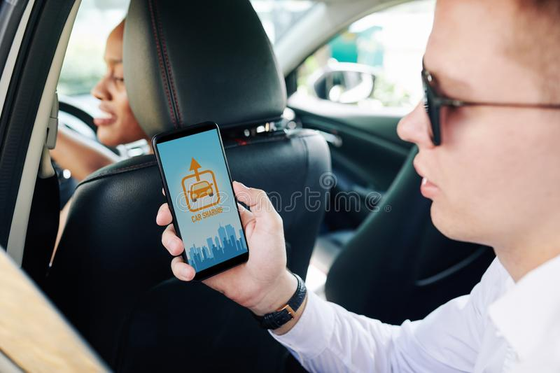 Man using car sharing app stock photo