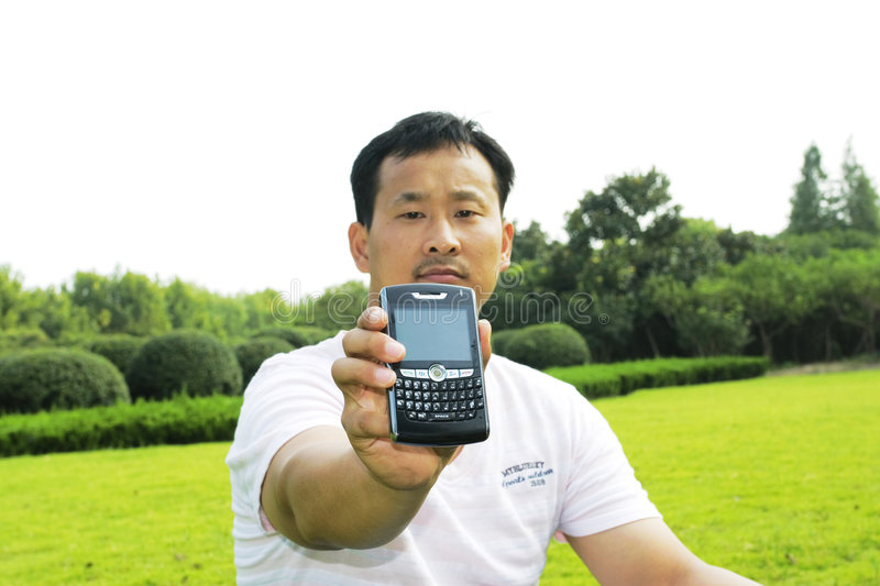 Download The Man Using Cell Phone Royalty Free Stock Image - Image: 6617656