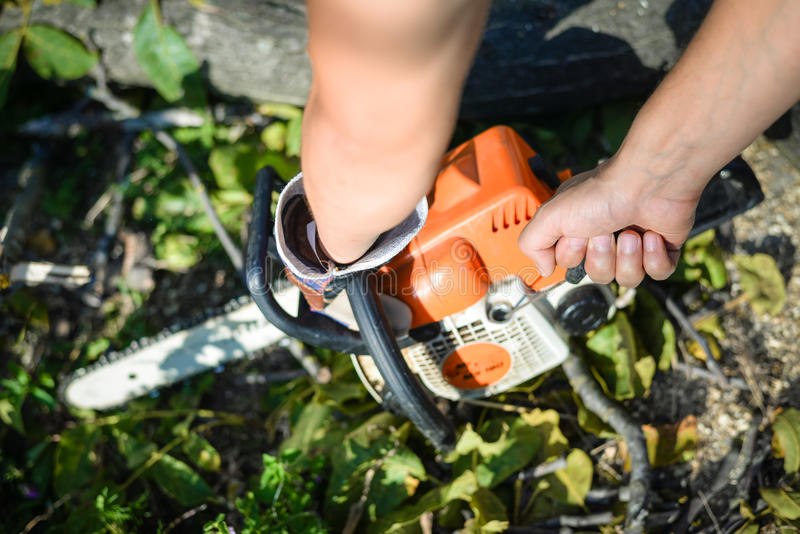Man using chainsaw. closeup of his hands royalty free stock photos